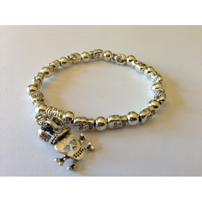 Skull and Crown charm on a Silver-Tone Skull and Beads Bracelet